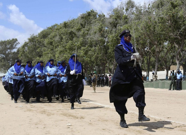 Somali policewomen march in a passing out parade during celebrations to mark the Somali Police Force's 70th founding anniversary in the capital Mogadishu December 20, 2013. (REUTERS/Feisal Omar)