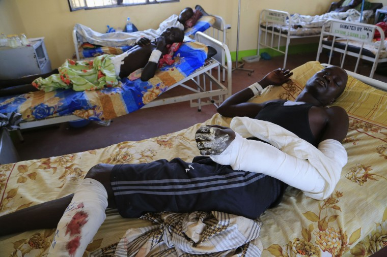 Wounded South Sudan military personnel lie in bed as they undergo medical treatment at the general military hospital in capital Juba December 28, 2013. South Sudan said on Friday it was ready for a ceasefire and would release eight of 11 senior politicians arrested over an alleged coup plot, raising hopes it was edging towards a deal to end ethnic-based fighting ravaging the world's newest nation. (REUTERS/James Akena)