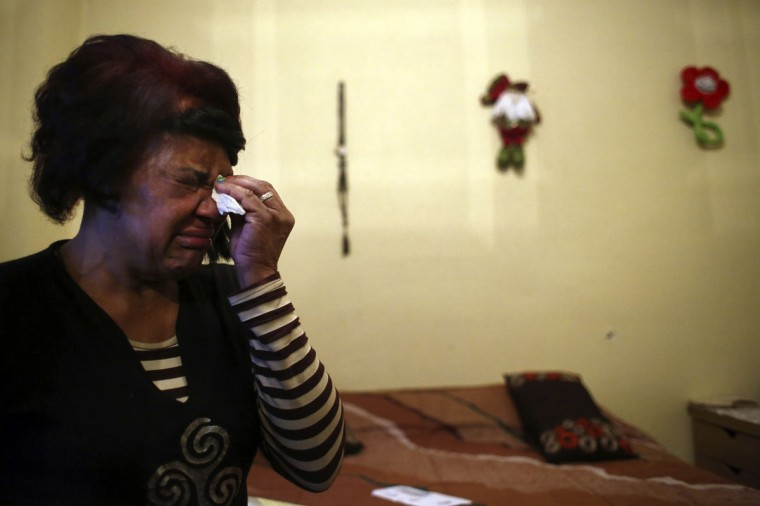 Antonia Mendez de Sangroni, 63, who came from Venezuela, cries before learning that her eviction had been suspended in Madrid December 19, 2013. The house where Mendez de Sangroni lives was bought by her son, Sandy Villal, six years ago. After becoming unemployed, he stopped making his mortgage payments and left for the U.S. in search for work, leaving his mother behind. Mendez de Sangroni, who suffers from arthrosis, does not hold a steady job and tries to get by, by selling clothes from a whole supplier. Her eviction has been postponed indefinitely due to ongoing negotiations with Spanish nationalized lender Bankia. (REUTERS/Susana Vera)