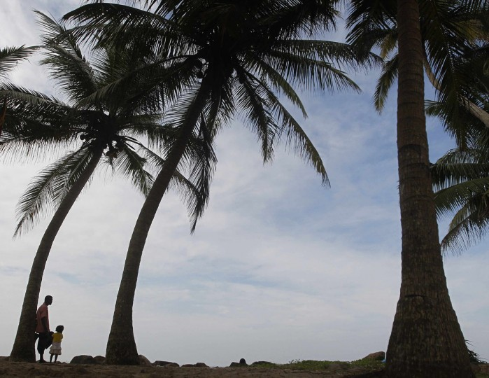 A father and his daughter look towards the sea during the 9th anniversary of the 2004 Asian tsunami in Peraliya, about 90 km (56 miles) south of Colombo December 26, 2013. Hundreds of memorial events were held across Asia in memory of the towering waves that crashed ashore with little warning on December 26, 2004, killing around 230,000 people in Indonesia, Sri Lanka, India, Thailand and nine other countries. More than half the victims were Indonesians; with Sri Lanka and India next worst hit. (REUTERS/Dinuka Liyanawatte)