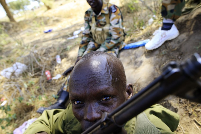 A South Sudan army soldier holds his weapon in Bor, 108 miles northwest from Juba, December 25, 2013. South Sudanese troops have retaken the flashpoint town of Bor in Jonglei state, a week after the town fell to rebels loyal to rebel leader Riek Machar. (James Akena/Reuters)