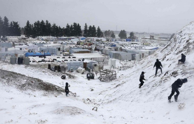 Syrian refugees play with snow during a winter storm in Zahle town, in the Bekaa Valley. The worst of winter is yet to come for 2.2 million refugees living outside Syria and millions more displaced inside the country. A storm named Alexa is sweeping across Syria and Lebanon, bringing with it high winds and freezing temperatures - and marking the beginning of the third winter since the Syrian conflict began in March 2011. In the tented settlement a few kilometres from the border in Lebanon's Bekaa Valley, more than 1,000 people live in rudimentary shelters. (Mohamed Azakir/Reuters)