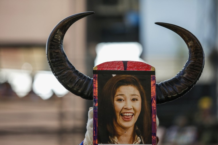 An anti-government protester holds a portrait of Prime Minister Yingluck Shinawatra during a rally at Dindang police station, near the Thai-Japan Youth Stadium in Bangkok December 23, 2013. The Thai baht plumbed its lowest level in almost four years on Monday as a political crisis grew more intractable, with anti-government protesters attempting to stop candidates from registering for a February election. (Athit Perawongmetha/Reuters)