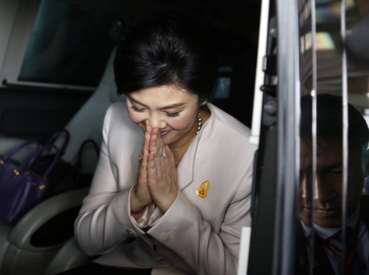 Thai Prime Minister Yingluck Shinawatra bids farewell after a news conference at The Army Club in Bangkok December 10, 2013. Yingluck pleaded on Tuesday for anti-government demonstrators to clear the streets and support a snap election, but defiant protest leaders called for her to step down within 24 hours. (Athit Perawongmetha/Reuters)