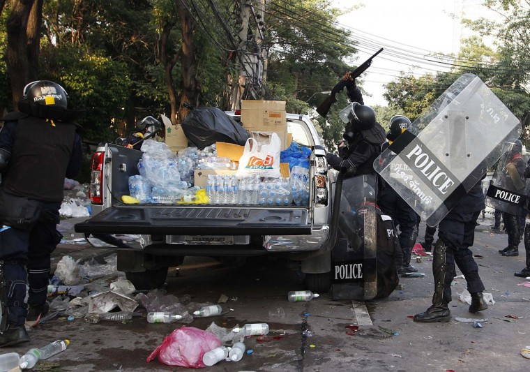 Riot policemen hit a pick up truck belonging to anti-government protesters during a clashes outside the Thai-Japan youth stadium in central Bangkok December 26, 2013. Thai police fired teargas at anti-government protesters in the capital Bangkok on Thursday after demonstrators tried to disrupt planning for a February election, the first such incident in nearly two weeks. (REUTERS)