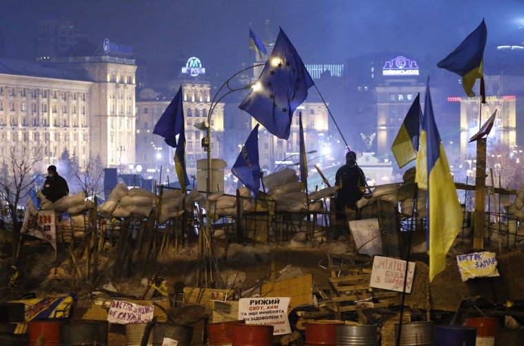 Ukrainian pro-EU demonstrators stand guard on a barricade during a rally at Independence Square in central Kiev December 20, 2013. (REUTERS/Marko Djurica)