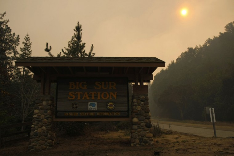Heavy smoke from wildfires engulfs the Big Sur Station, in Big Sur, California, December 17, 2013. The wildfire that erupted in a scenic stretch of California's central coastline late Sunday night has destroyed at least 15 homes and forced many residents to evacuate, county and fire officials said. The ranger station is the headquarters for the firefighting operations. (REUTERS/Michael Fiala)