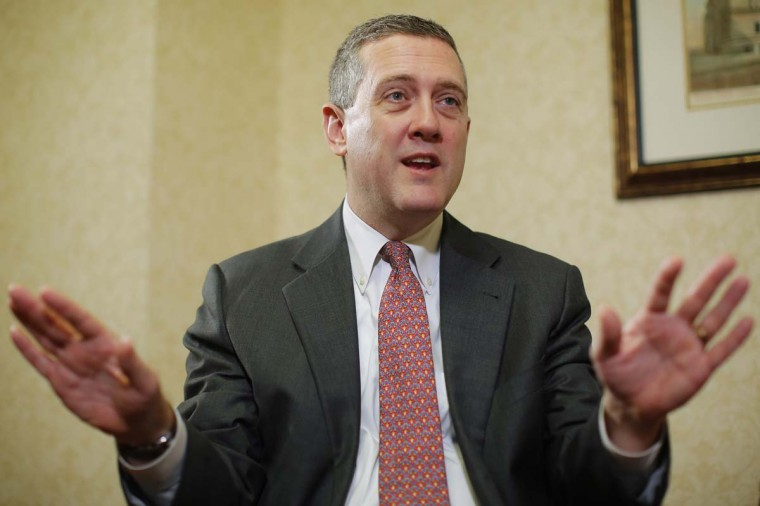 "James Bullard, President of the St. Louis Federal Reserve Bank, speaks during an interview with Reuters in an August file photo. Remarks last week from Bullard voicing support for a ""small taper"" were unexpected. He joined a chorus of more-hawkish officials, including two on Monday, who also want to begin trimming the central bank's $85 billion per month asset-purchase pace. Investors around the world are waiting to hear the results of this week's Fed meeting. (REUTERS/Brian Snyder/Files)"