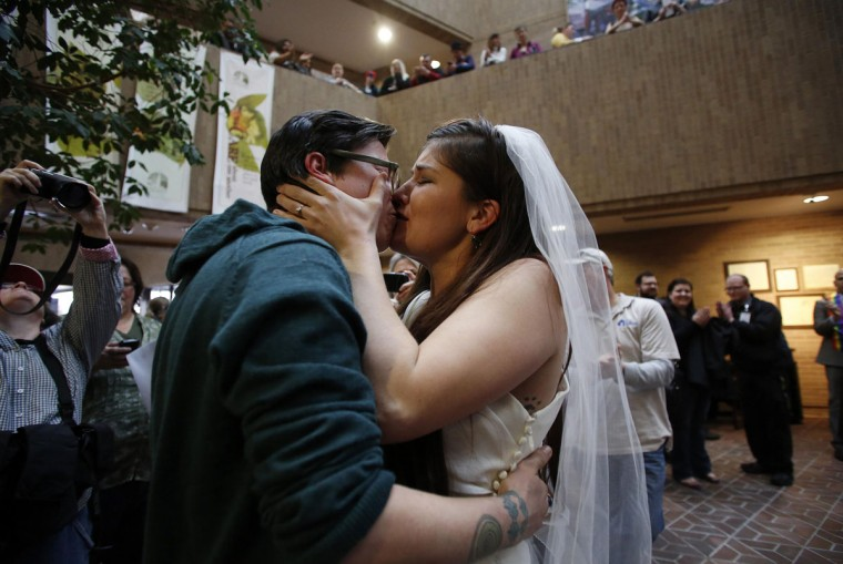 Jax (left) and Heather Collins share a kiss after getting married at the Salt Lake County Government Building in Salt Lake City, Dec. 23, 2013. (Jim Urquhart/Reuters)