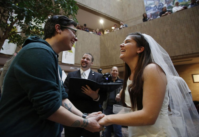 Jax Collins (left) and Heather Collins get married at the Salt Lake County Government Building in Salt Lake City, Dec. 23, 2013. U.S. District Judge Robert Shelby in Utah on Monday refused to temporarily block his own order making same-sex marriage legal in the state. (Jim Urquhart/Reuters)