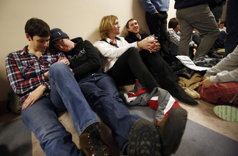 Tarah Camarillo (from left), her partner Nicole Barnes, Leighton Hilburn and his partner Preston Perry wait in line with hundreds of other people to apply for a marriage license at the Salt Lake County Clerks office in Salt Lake City, Utah, Dec. 23, 2013. (Jim Urquhart/Reuters)