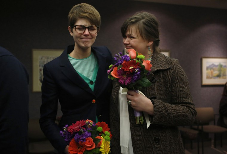 Natalie Dicou (left) and her partner Nicole Christensen wait to get married at the Salt Lake County clerk's office in Salt Lake City, Friday, December 20, 2013. A federal judge struck down Utah's ban on same-sex marriage as unconstitutional on Friday, handing a major victory to LGBT rights activists in a state where the Mormon church wields considerable influence. (Jim Urquhart/Reuters)