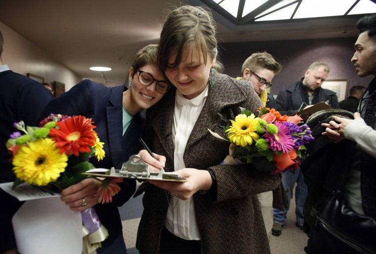 Natalie Dicou (left) and her partner Nicole Christensen wait to get married at the Salt Lake County clerk's office in Salt Lake City, Utah, Dec. 20, 2013. (Jim Urquhart/Reuters)