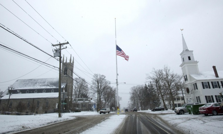 The town flag flies at half staff in remembrance of the victims of the shootings at Sandy Hook Elementary School in Newtown, Connecticut December 14, 2013. December 14th marks the one year anniversary of the shooting rampage at Sandy Hook Elementary School, where 20 children and six adults were killed by gunman Adam Lanza. (REUTERS/Michelle McLoughlin)