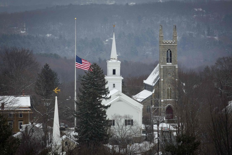 The town flag flies at half staff in Newtown, Connecticut December 14, 2013. Today marks the one year anniversary of the shooting rampage at Sandy Hook Elementary School, where 20 children and six adults were killed by gunman Adam Lanza. (REUTERS/Carlo Allegri)