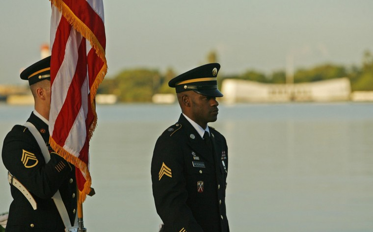 The US Army Color Guard stands at attention at the Arizona Memorial during the 72nd anniversary of the attack on Pearl Harbor at the WW II Valor in the Pacific National Monument in Honolulu, Hawaii on December 7, 2013. (REUTERS/Hugh Gentry)