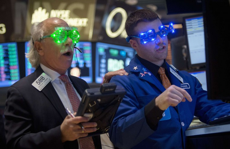 Traders, wearing novelty 2014 glasses, trade at the closing bell on the floor of the New York Stock Exchange on New Year's Eve in New York, December 31, 2013. (REUTERS/Carlo Allegri)