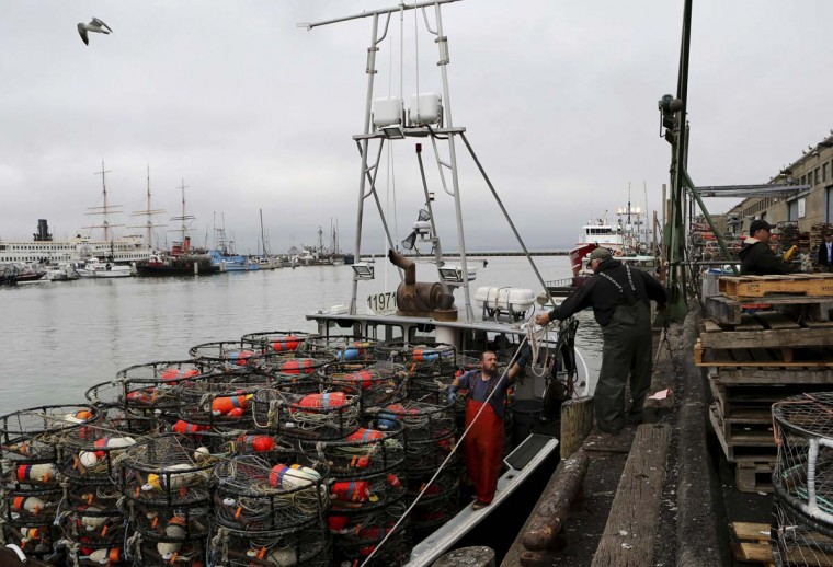 Fishing vessels loaded with pots will become a more common site this week on the West Coast: Oregon's commercial Dungeness crab season is scheduled to open Monday, December 16. (Reuters file photo by Robert Galbraith)