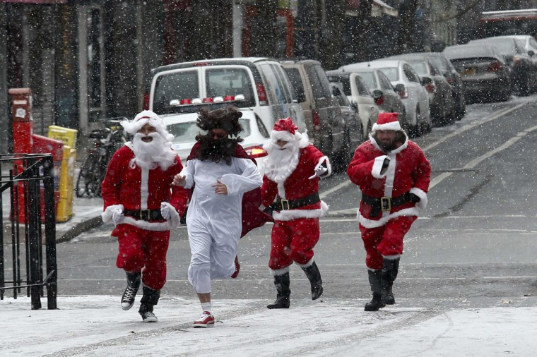 Three revellers dressed as Santa Claus run in park during the SantaCon event in New York December 14, 2013. Every year since 1997, thousands of men and women have dressed up as Santas, elves, reindeer or some other holiday confection and descended on the city's streets for a daylong bar crawl that begins with good cheer and, for many, inevitably ends in a blurry booze-soaked haze. Many come from Long Island and New Jersey, getting a head start on the festivities on the train ride into the city. (REUTERS/Eduardo Munoz)