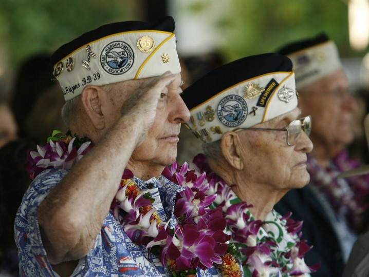 """USS Arizona survivor Louis Conter salutes during the """"Moment of Silence"""" during the 72nd anniversary of the attack on Pearl Harbor at the WW II Valor in the Pacific National Monument in Honolulu, Hawaii on December 7, 2013. (REUTERS/Hugh Gentry)"""