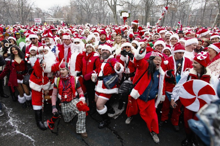 Revellers dressed as Santa Claus pose for a picture at a park during the SantaCon event in New York December 14, 2013. Every year since 1997, thousands of men and women have dressed up as Santas, elves, reindeer or some other holiday confection and descended on the city's streets for a daylong bar crawl that begins with good cheer and, for many, inevitably ends in a blurry booze-soaked haze. Many come from Long Island and New Jersey, getting a head start on the festivities on the train ride into the city. (REUTERS/Eduardo Munoz)