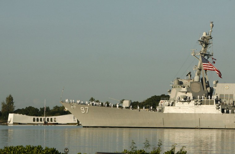 The USS Halsey passes the Arizona Memorial during the 72nd anniversary of the attack on Pearl Harbor at the WW II Valor in the Pacific National Monument in Honolulu, Hawaii on December 7, 2013. (REUTERS/Hugh Gentry)