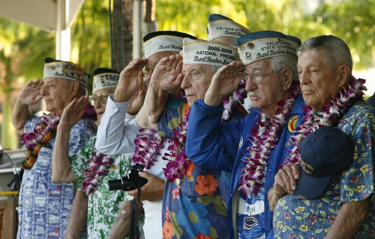 Pearl Harbor survivors salute as the USS Halsey passes the Arizona Memorial during the 72nd anniversary of the attack on Pearl Harbor at the WW II Valor in the Pacific National Monument in Honolulu, Hawaii on December 7, 2013. (REUTERS/Hugh Gentry)