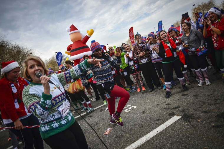 Jaime Padgett (L) of Centreville, Virginia sings karaoke during the Ugly Sweater Run at National Harbor in Fort Washington, Maryland December 21, 2013. (REUTERS/James Lawler Duggan)