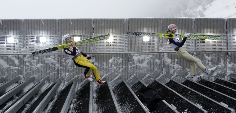 Simon Ammann of Switzerland and Austria's Martin Koch walk down the stairs for their practice jump on the Large Hill HS134 at the Nordic Ski World Championships in Oslo on March 1, 2011. (REUTERS / Petr Josek)