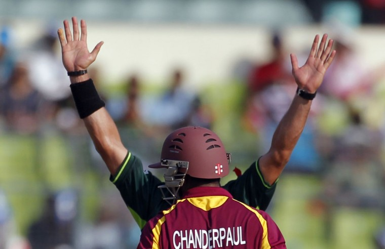 Pakistan's Shahid Afridi unsuccessfully appeals for West Indies' Ramnaresh Sarwan as he stands behind West Indies' Shivnarine Chanderpaul during their Cricket World Cup 2011 quarterfinal match in Dhaka on March 23, 2011. (REUTERS / Adnan Abidi)