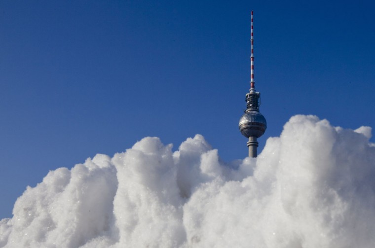 Snow is piled up near the landmark Fernsehturm television tower on a sunny winter day in Berlin on February 3, 2011. (REUTERS / Thomas Peter)