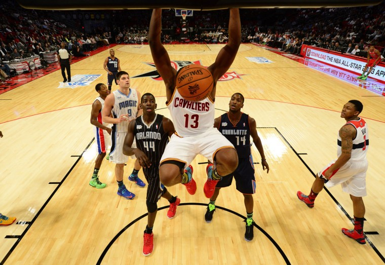Cleveland Cavaliers forward Tristan Thompson hangs on the rim after a dunk during the first half of the NBA BBVA Rising Star Challenge basketball game in Houston, Texas, on February 15, 2013. (REUTERS / Bob Donnan)