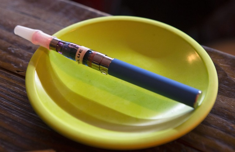 An e-cigarette sits in a tray on the bar at the Henley Vaporium in New York City December 18, 2013. At the Henley Vaporium, one of a growing number of e-cigarette lounges sprouting up in New York and other U.S. cities, patrons can indulge in their choice of more than 90 flavors of nicotine-infused vapor, ranging from bacon to bubble gum. (Mike Segar/Reuters)