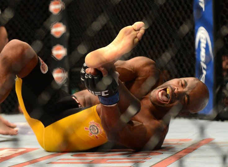 Anderson Silva reacts after breaking his leg on a kick to Chris Weidman (not pictured) during their UFC middleweight championship bout at the MGM Grand Garden Arena. (Jayne Kamin-Oncea/USA TODAY Sports )