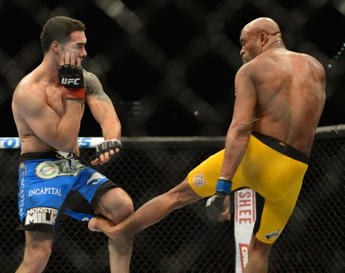 Anderson Silva (blue gloves) breaks his leg on a kick to Chris Weidman (red gloves) during their UFC middleweight championship bout at the MGM Grand Garden Arena. (Jayne Kamin-Oncea/USA TODAY Sports )