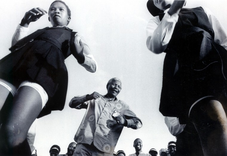 ANC leader Nelson Mandela, who expects to be South Africa's president after April 26-28 election, joins in a festive dance with seventh graders from Steadville High School, who were among thousands at a Natal rally. ( Washington Post photo by Michael Williamson)