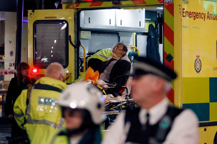 Injured people are taken to the hospital by ambulance after the collapse of a ceiling at The Apollo Theatre in London, England. Police and emergency services attended the historic London theatre after the incident during a performance of The Curious Incident of the Dog in The Night-Time. (Mary Turner/Getty Images)