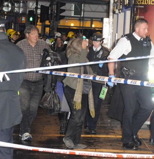 Injured people are treated nearby the Queens Theatre before being taken by bus to a hospital after the roof collapsed at The Apollo Theatre in London, England. A number of people have been seriously injured after part of the roof of the famous West End theatre collapsed during a packed performance of 'The Curious Incident of the Dog in the Night-Time'. (Alan Chapman/Getty Images)