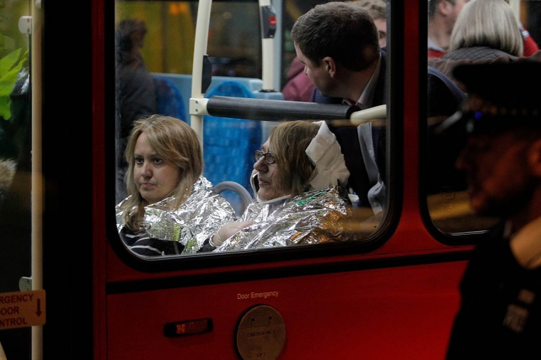 Injured people are taken away in a London bus from the Queens Theatre after the collapse of a ceiling at The Apollo Theatre in London, England. A number of people have been seriously injured after part of the roof of the famous West End theatre collapsed during a packed performance of 'The Curious Incident of the Dog in the Night-Time'. (Photo by Mary Turner/Getty Images)