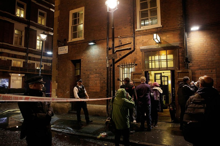 People gather at the stage door of the Apollo Theatre on Shaftesbury Avenue, after the collapse of a ceiling at historic theatre in London, England. A number of people have been seriously injured after part of the ceiling of the famous West End theatre collapsed during a packed performance of 'The Curious Incident of the Dog in the Night-Time'. (Mary Turner/Getty Images)