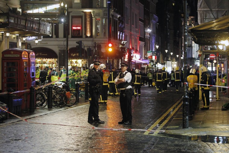 Police and ambulance services are on Rupert Street, behind the Apollo Theatre after the collapse of a ceiling during a performance at the theatre in London, England. A number of people have been seriously injured after part of the ceiling of the famous West End theatre collapsed during a packed performance of 'The Curious Incident of the Dog in the Night-Time'. (Mary Turner/Getty Images)