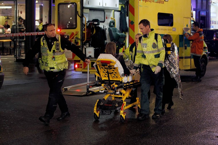Injured people are taken to the hospital by ambulance after the collapse of a ceiling at The Apollo Theatre in London, England. A number of people have been seriously injured after part of the ceiling of the famous West End theatre collapsed during a packed performance of 'The Curious Incident of the Dog in the Night-Time'. (Mary Turner/Getty Images)