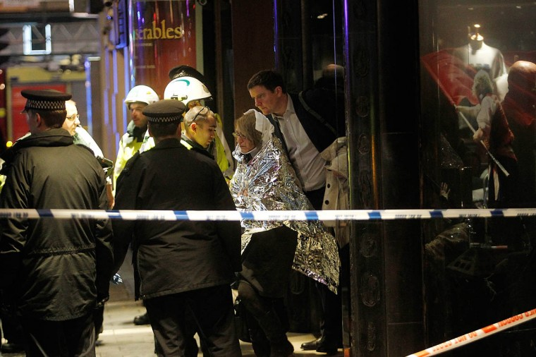 Injured people leave the neighboring Queens Theatre and are taken to the hospital by ambulance after the collapse of a ceiling at The Apollo Theatre in London, England. A number of people have been seriously injured after part of the ceiling of the famous West End theatre collapsed during a packed performance of 'The Curious Incident of the Dog in the Night-Time'. (Mary Turner/Getty Images)