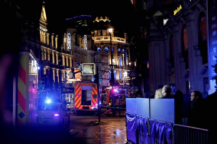 Police and fire crews in attendance on Shaftesbury Avenue outside the Apollo Theatre after the collapse of a balcony during a performance at the theatre in London, England. A number of people have been seriously injured after part of the ceiling of the famous West End theatre collapsed during a packed performance of 'The Curious Incident of the Dog in the Night-Time'. (Mary Turner/Getty Images)