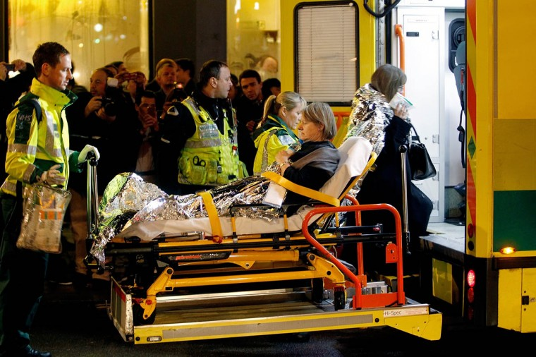 Injured people are taken to the hospital by ambulance after the collapse of a balcony at The Apollo Theatre in London, England. A number of people have been seriously injured after part of the roof of the famous West End theatre collapsed during a packed performance of 'The Curious Incident of the Dog in the Night-Time'. (Mary Turner/Getty Images)