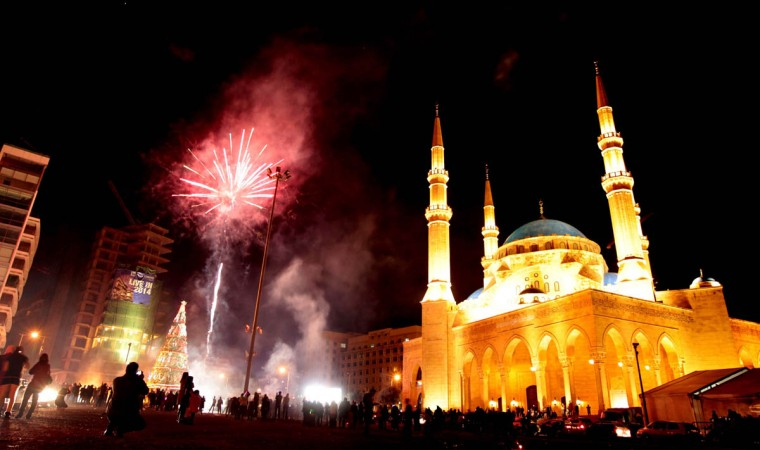 Fireworks light up the sky in downtown Beirut close to the Mohammed al-Amin mosque as Lebanon rings in the New Year. (Getty Images)