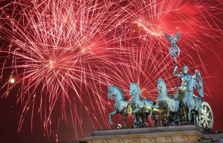 Fireworks explode behind the Quadriga statue on top of the Brandenburg Gate shortly after midnight in Berlin, Germany. Tens of thousands of revelers gathered in the city center to celebrate New Year's Eve. (Adam Berry/Getty Images)