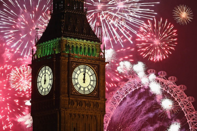 Fireworks light up the London skyline and Big Ben just after midnight in London, England. Thousands of people lined the banks of the River Thames in central London to see in the New Year with a spectacular fireworks display. (Dan Kitwood/Getty Images)