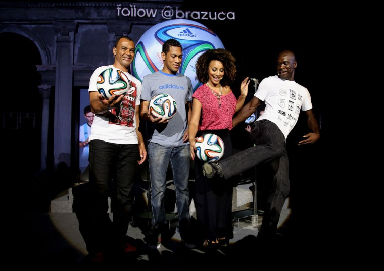 Cafu, Hernane, Sheron Menezzes and Seedorf pose with the World Cup Brazuca ball during the adidas Brazuca launch at Parque Lage in Rio de Janeiro, Brazil. (Photo by Friedemann Vogel/Getty Images for adidas)