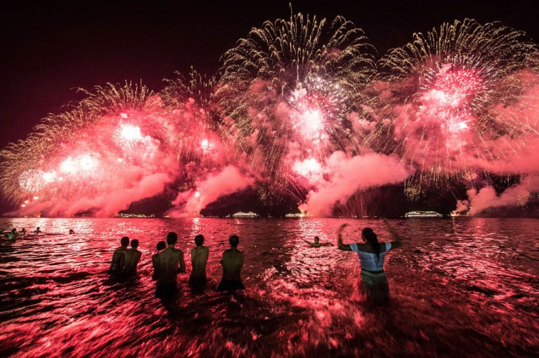 People react to the fireworks on the new year's celebration at Copacabana beach in Rio de Janeiro, Brazil. (Yasuyoshi Chiba/Getty Images)